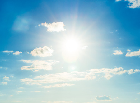 sunny sky: Blue sky with clouds and sun.