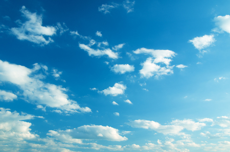 sunny season: white fluffy clouds in the blue sky