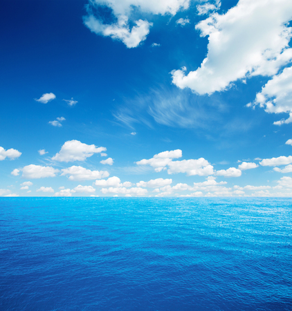azul turqueza: Cloudy sky and sea. Sea summer shot Foto de archivo