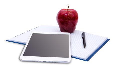 bookshelf digital: tablet and stack of books