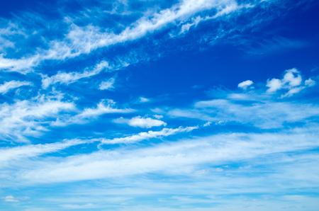 blue sky background with tiny clouds Фото со стока