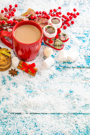 Christmas decoration hanging over wooden background Stock Photo