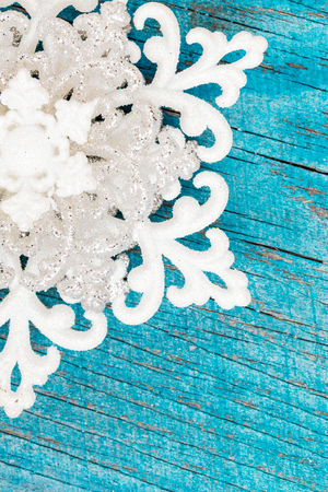 Christmas snowflake ornament on rustic style grunge background