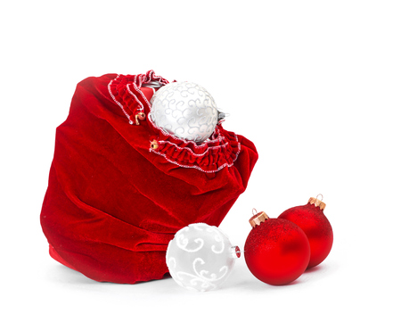 Santa Claus red bag with Christmas balls and gift box