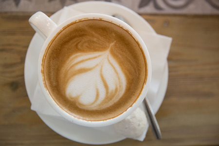 cappuccino foam: A cup of cappuccino with foam art Stock Photo