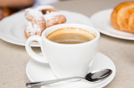 cip: A cip of coffee with croissant and danish in a French coffee shop Stock Photo