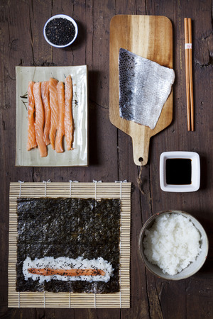 sushi chopsticks: overhead shot of ingredients for preparing sushi on wooden table Stock Photo
