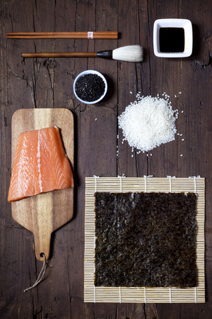 sushi chopsticks: overhead shot of ingredients for sushi on wooden table