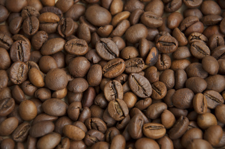 caffiene: Brown coffee beans, close-up of coffee beans for background and texture  Stock Photo