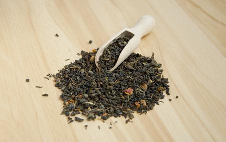 pekoe: dried green tea on wooden surface