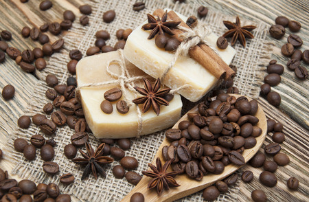 beauty care: Handmade soap with coffee beans and spices on a wooden background