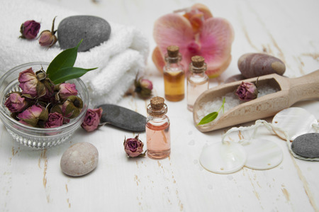 Spa composition. Sea salt, essential aroma oil on wooden background photo