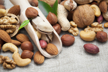 Mixed nuts on a wooden background photo