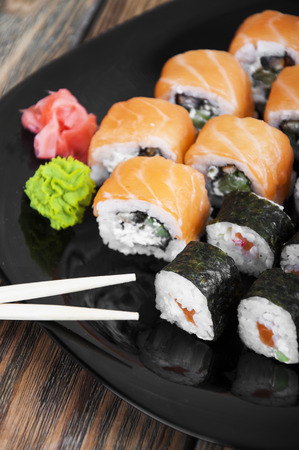sushi roll: Different sushi rolls,wasabi and ginger on a plate