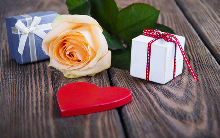 boxs: Gift boxs,red heart and beautiful rose on wooden dark background