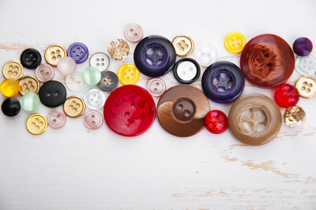 Sewing Supplies on Wood Background photo