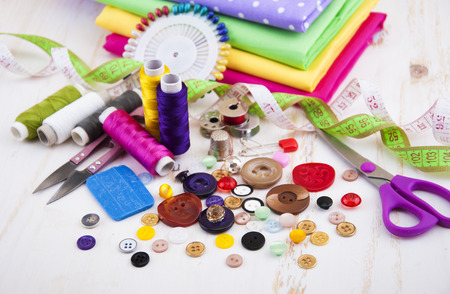 Set of different sewing accessories,fabrics and thread spools Banco de Imagens