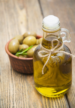 olive oil: Olives and Olive Oil on wooden table