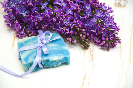 vin: Handmade soap with lilac flowers on a wooden background