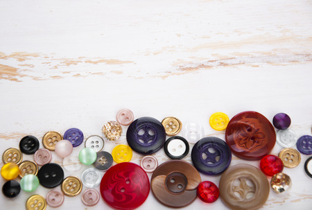 sewing supplies: Sewing Supplies on Wood Background Stock Photo