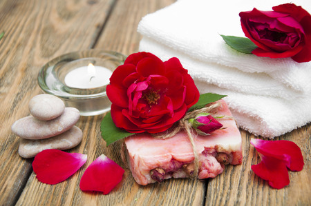 handmade soap: Rose handmade soap with flowers roses on a wooden background