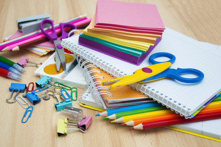 school book: School supplies on the table