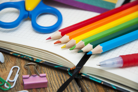 colored school: School supplies on the table