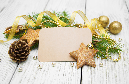 religious life: Christmas decorations with greeting card on a white wooden background