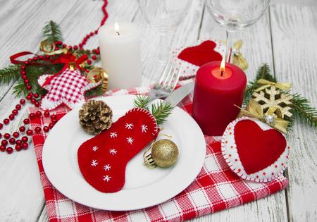 glass christmas tree ornament: Christmas table setting with christmas decorations.