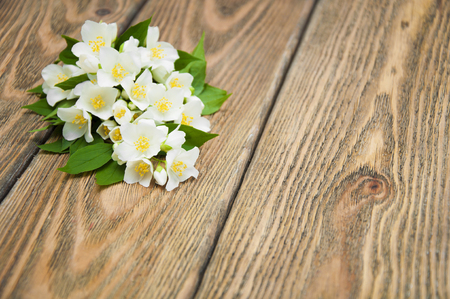redolence: Jasmine bouquet on a wooden background