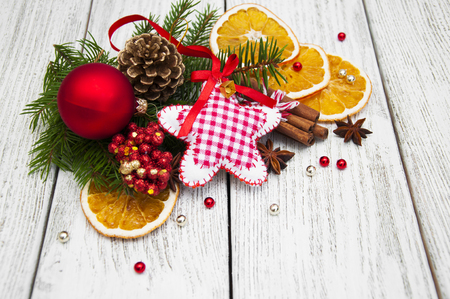 hape: Christmas decorations with spices on a wooden background Stock Photo