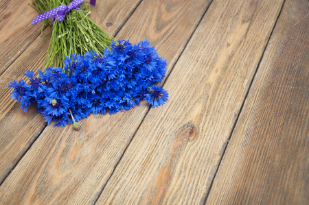 cornflowers: Bouquet of cornflowers on a wooden background Stock Photo