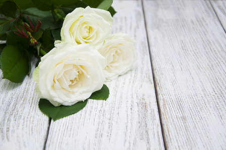 Beautiful white roses on a wooden background 写真素材