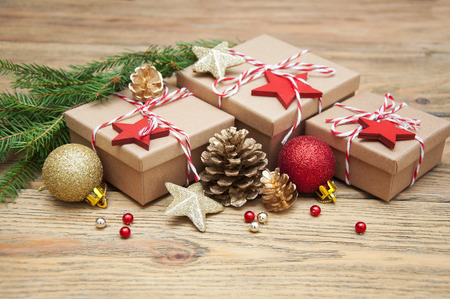 Christmas gift boxes and decorations on wooden background 写真素材