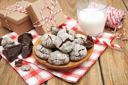 Crackled chocolade cookies on a old wooden background