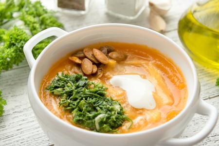 Homemade pumpkin soup with sour cream Stock Photo