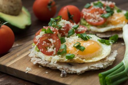 Huevos rancheros tostadas with avocado salsa with veggies