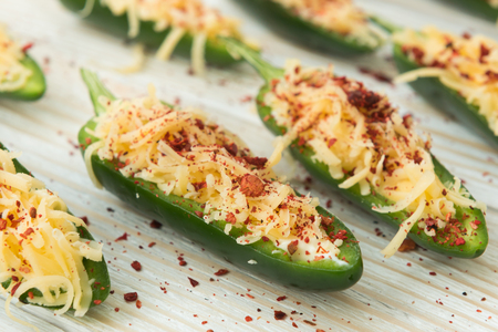 Cooking fresh fried jalapeno poppers with cheese Standard-Bild