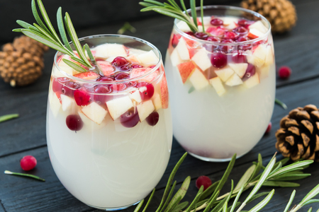 New Year sangria with cranberries, apples and rosemary Stock Photo