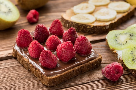 Toasts with fresh fruits and berries for breakfast Standard-Bild