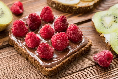 Toasts with fresh fruits and berries for healthy breakfast
