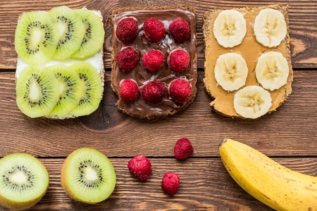 Toasted gluten free bread with fresh fruits and berries for breakfast