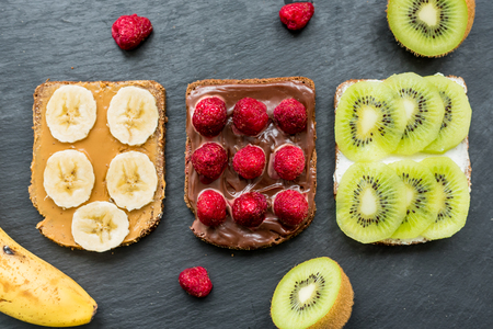 Whole wheat toasted bread with fresh fruits and berries for breakfast