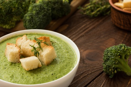 Ready cream - soup with broccoli in white bowl and crouton