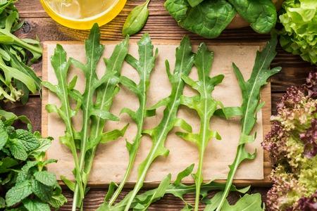 Fresh homegrown washed arugula on the cutting board Standard-Bild