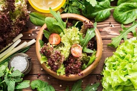 Fresh healthy vegetarian salad in vintage bowl