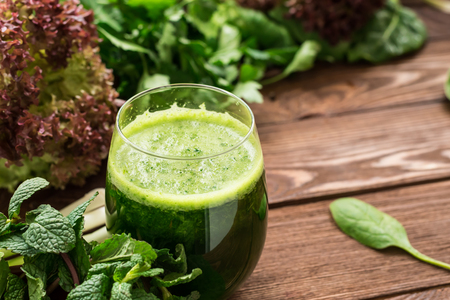 Refreshing healthy vegetarian smoothie from greens on the table