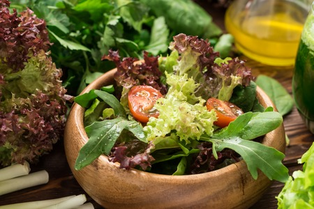 Fresh ready to eat salad from greens, cherry tomatoes and spices Standard-Bild