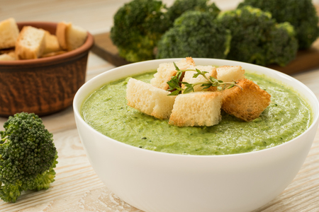Cream - soup with broccoli served in white bowl