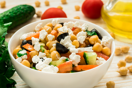 Chickpea salad with cucumber, cherry tomatoes, feta and olives